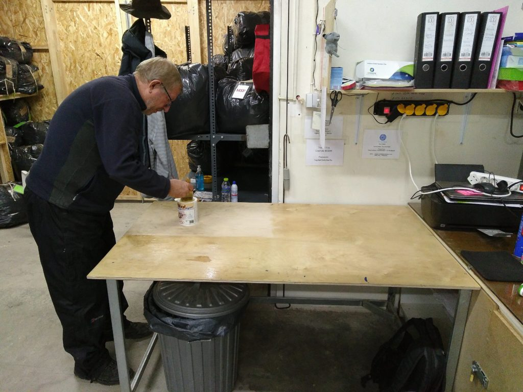 Ross varnishing the office table in the laundry